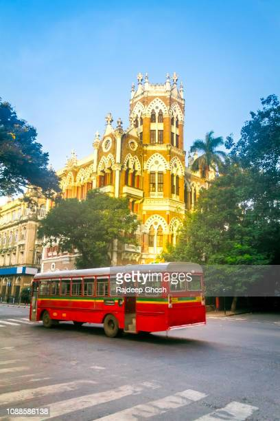 mumbai bus and colonial building - mumbai stock pictures, royalty-free photos & images