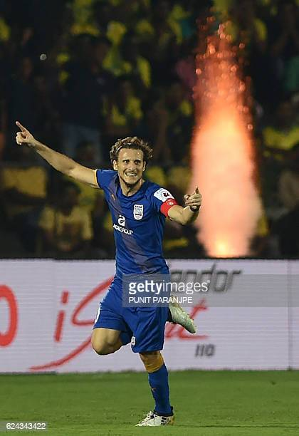 Mumbai City FC captain Diego Forlan celebrates after scoring a goal during the Indian Super League football match between Kerala Blasters FC and...