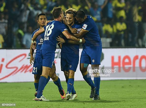 Mumbai City FC captain Diego Forlan celebrates with teammates after scoring a goal during the Indian Super League football match between Kerala...