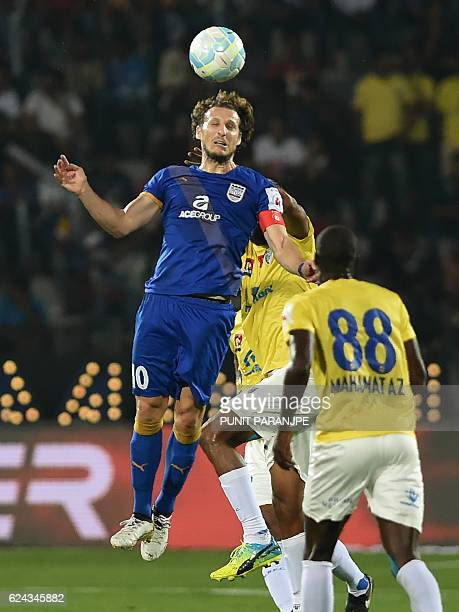 Mumbai City FC captain Diego Forlan tussles for the ball during the Indian Super League football match between Kerala Blasters FC and Mumbai City FC...