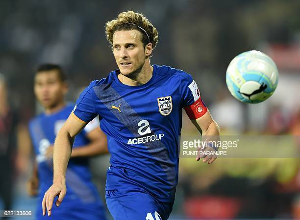 Mumbai City FC captain Diego Forlan vies for the ball during the Indian Super League football match between FC Pune City and Mumbai City FC at The...