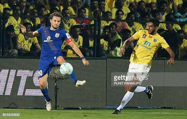 Mumbai City FC captain Diego Forlan vies for the ball during the Indian Super League football match between Kerala Blasters FC and Mumbai City FC at...
