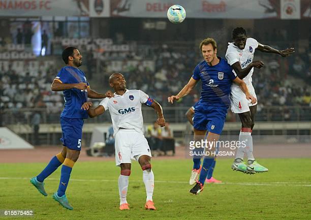 Mumbai City FC defender Anwar Ali Delhi Dynamos FC defender Florent Malouda Mumbai City FC midfielder Krisztián Vadócz and Delhi Dynamos FC defender...