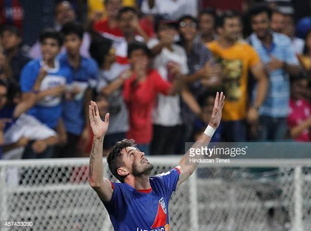 Mumbai City FC footballer Andre Moritz celebrates after scoring a goal during the Indian Super League football match between Mumbai City FC and FC...