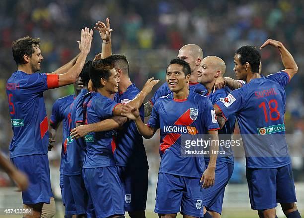 Mumbai City FC footballer celebrates with teammates after scoring a goal during the Indian Super League football match between Mumbai City FC and FC...