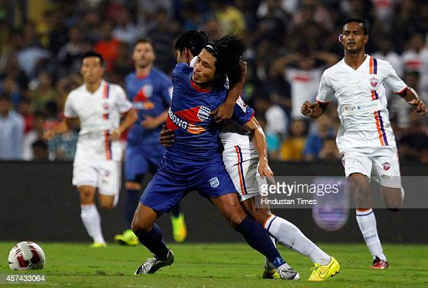 Mumbai City FC footballer fights for the ball against FC Pune City during the Indian Super League football match between Mumbai City FC and FC Pune...