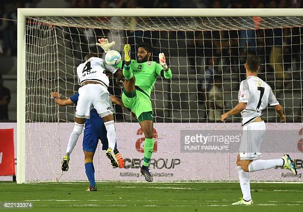 Mumbai City FC goalkeeper Albino Gomes tussles for the ball during the Indian Super League football match between FC Pune City and Mumbai City FC at...