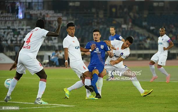 Mumbai City FC midfielder Leonardo Fabricio Soares Da Costa vies for the ball during the Indian Super League football match between Delhi Dynamos FC...