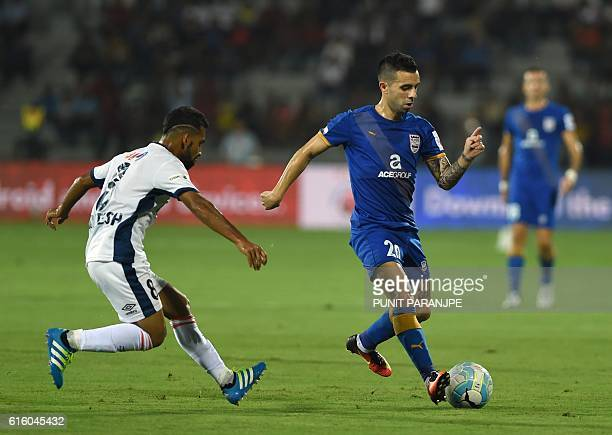 Mumbai City FC player Matias Defederico vies for the ball during the Indian Super League football match between FC Goa and Mumbai City FC at The...