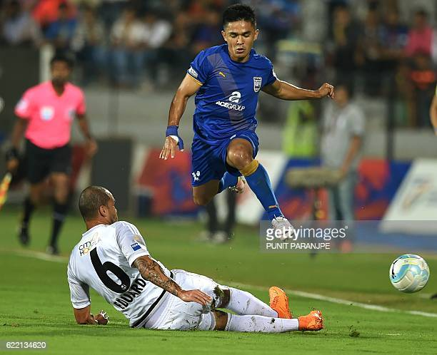 Mumbai City FC player Sunil Chhetri vies for the ball during the Indian Super League football match between FC Pune City and Mumbai City FC at The...