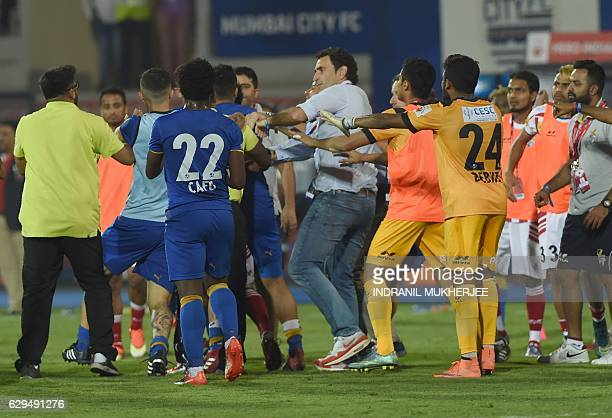 Mumbai City FC players and Athletico de Kolkata players scuffle after the Indian Super League second leg semifinal football match between Mumbai City...