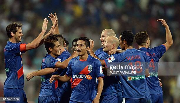 Mumbai City FC players celebrate after scoring a goal against FC Pune City during the Indian Super League football match between Mumbai City FC and...