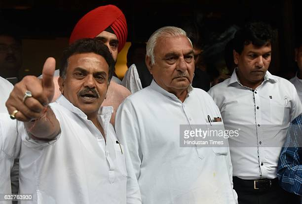Mumbai Congress President Sanjay Nirupam with former Chief Minister of Haryana Bhupinder Singh Hooda after the party internal meeting to take of the...