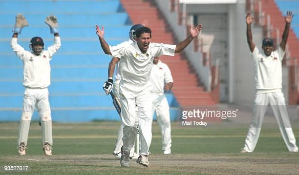 Mumbai Cricket player Ajit Agrkar celebrates after taking a wicket at a Ranji Trophy Super League match between Railway VS Mumbai in New Delhi on...