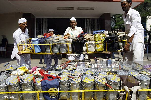 Mumbai dabbawallas or lunchbox deliverymen carry a crate of tiffin boxes in Mumbai 15 November 2007 Using the Mumbai commuter rail network lunchbox...