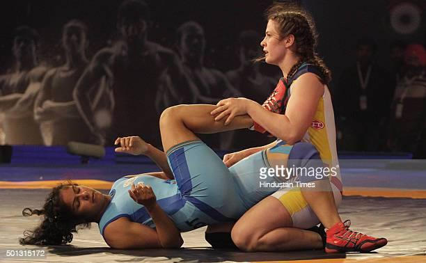 Mumbai Garudas wrestler Adeline Gray grapples with Navjot Kaur of Bengaluru Yodhas in women's 69kg category during the Pro Wrestling League at Guru...