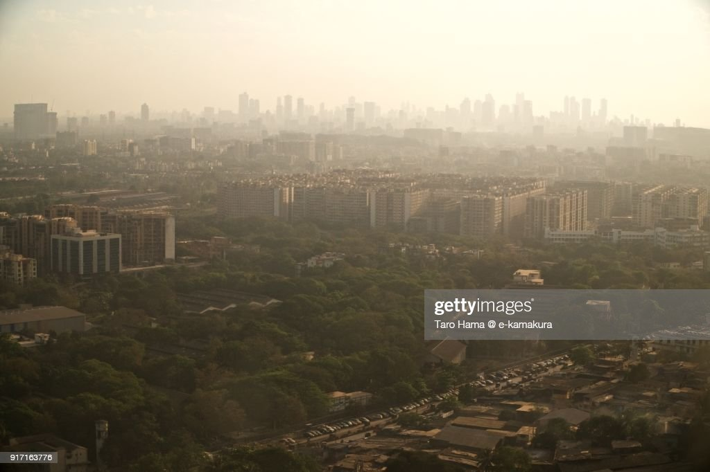 Mumbai in Maharashtra in India sunset time aerial view from airplane : ストックフォト