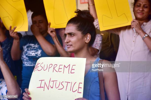 """Mumbai, India. 09 May, 2019. Women protest against unilateral and unfair """"Clean Chit"""" to CJI Ranjan Gogoi in a sexual harassment case at..."""