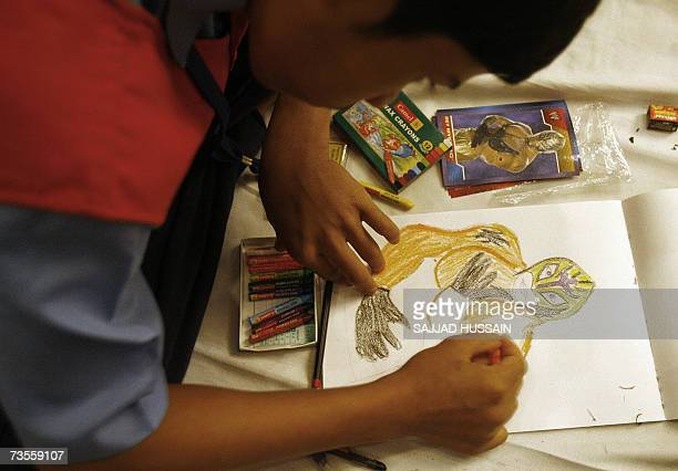 An Indian child draws a sketch of World Wrestling Entertainment entertainer US Rey Mysterio in Mumbai 13 March 2007 Some 40 children from a local...