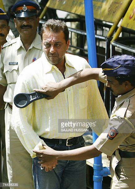An Indian policeman carries out security checks on Bollywood movie actor Sanjay Dutt as he arrives at the Terrorist And Disruptive Activities Court...