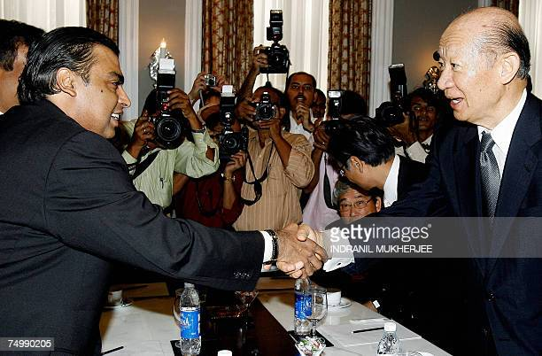 Chairman of India's biggest private company Reliance Industries Mukesh Ambani greets Chairman of the Board Tokyo Stock Exchange Taizo Nishimuro on...