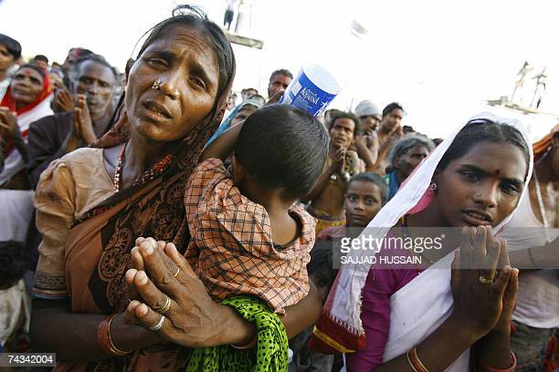 Hindu dalits pray during a mass conversion to Buddhism ceremony in Mumbai 27 May 2007 Thousands of lowcaste and tribal Hindus seeking freedom from...