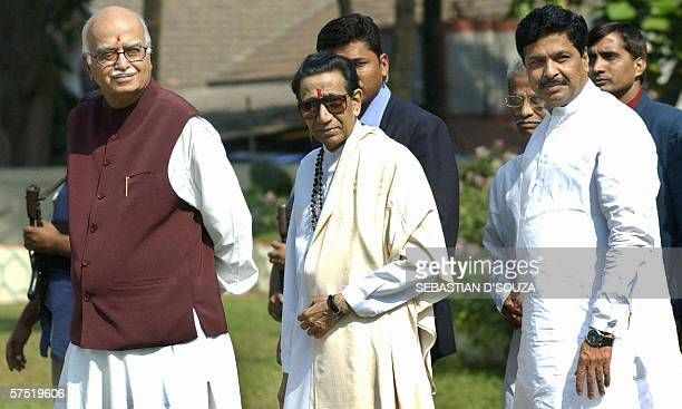 In this file picture taken 30 December 2003 Indian rightwing Hindu politician Bal Thackeray is flanked by then Indian Deputy Prime Minister Lal...