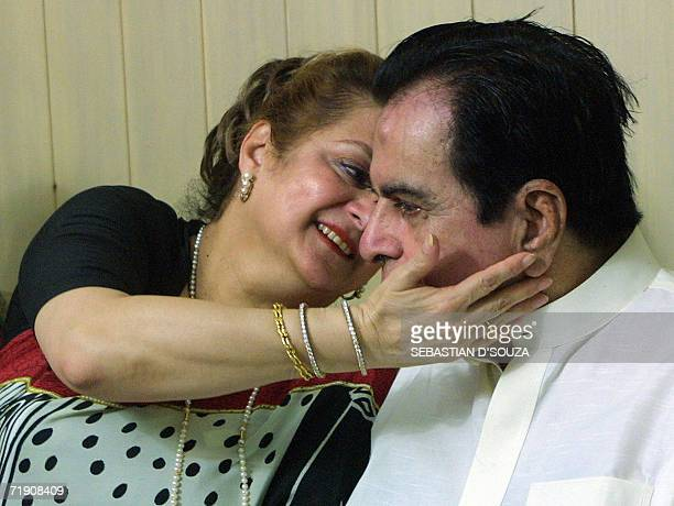 Indian actor Dilip Kumar is embraced by his wife Saira Banu at the announcement of the release of the Bhojpuri film Ab Ta Banja Sajanwa Hamaar in...