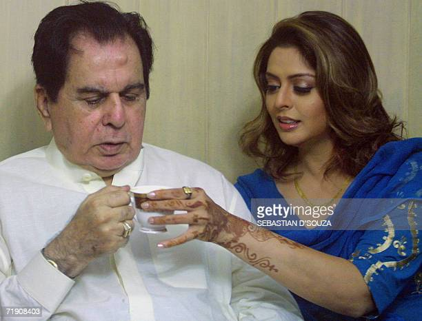 Indian actor Dilip Kumar is handed a cup of tea by actress Nagma at the announcement of the release of the Bhojpuri film Ab Ta Banja Sajanwa Hamaar...
