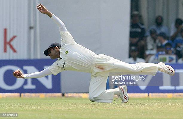 Indian cricket captain Rahul Dravid dives at first slip to take a catch England batsman Owais Shah on the second day of the third Test match between...