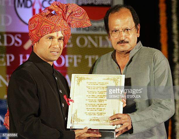 Indian cricketer Sachin Tendulkar is presented with a citation by former cricket captain Ajit Wadekar at a ceremony held in his honour by the Marathi...
