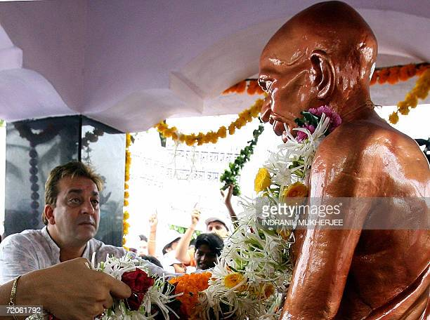 Indian film actor Sanjay Dutt offers flowers to a statue of the 'father of the nation' Mahatma Gandhi to pay homage on the occassion of Gandhi's 137...