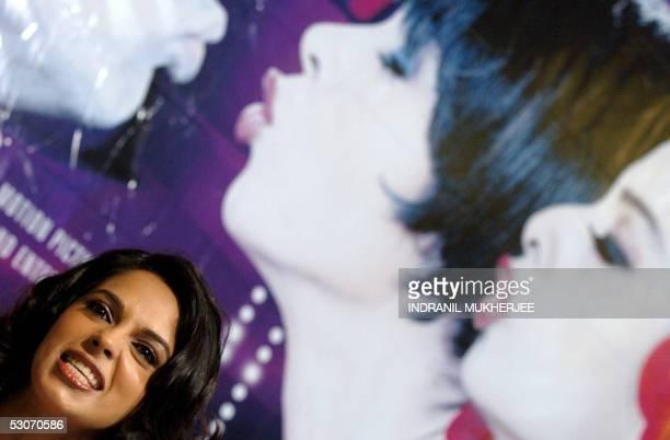 "Indian film actress Mallika Sherawat speaks at a function to promote her latest film ""Bachke Rehana Re Baba"" or Beware Guys in Mumbai, 15 June 2005...."