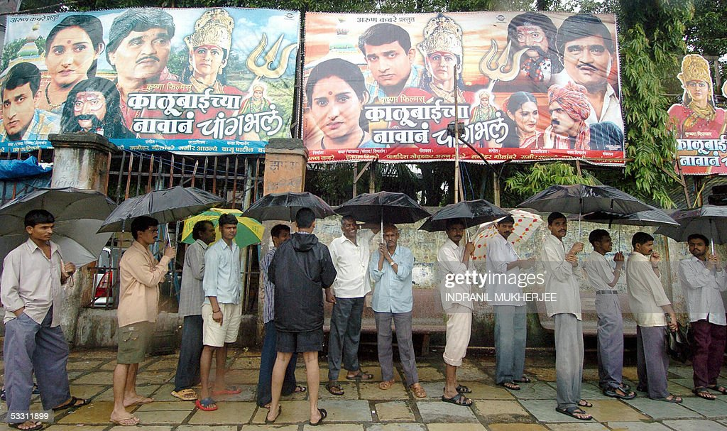 Fresh rain compounds india flood misery as death toll nears 1000 indian movie buffs queue up in the rain outside a cinema theatre in mumbai 01 august thecheapjerseys Images
