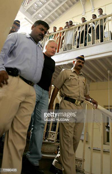Indian police officials escort a bodyguard of unseen US actress Angelina Jolie towards a court appearance in Mumbai 17 November 2006 Three of...