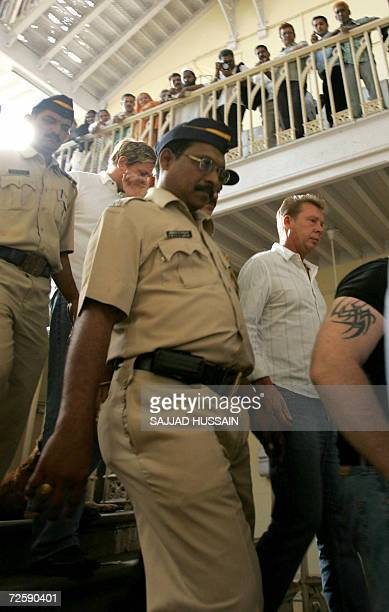 Indian police officials escort bodyguards of unseen US actress Angelina Jolie towards a court appearance in Mumbai 17 November 2006 Three of Angelina...