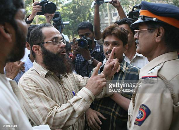 Indian policemen attempt to calm an angry parent outside the AnjumaniIslam School in Mumbai 16 November 2006 after he alledged that bodyguards for US...