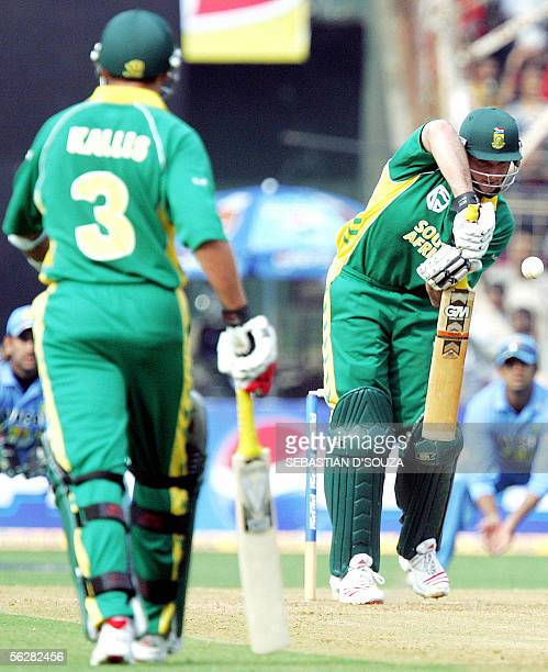 South African cricket captain Graeme Smith plays a defensive shot as team-mate Jacques Kallis looks on during the fifth and final one day...