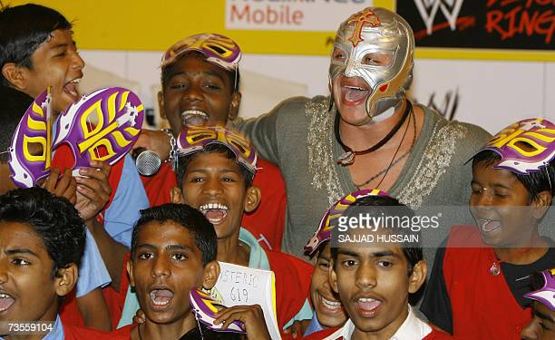 World Wrestling Entertainment entertainer US Rey Mysterio gestures as he meets schoolchildren in Mumbai 13 March 2007 Some 40 children from a local...
