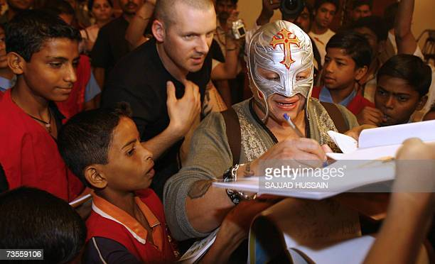 World Wrestling Entertainment entertainer US Rey Mysterio signs autographs as he meets schoolchildren in Mumbai 13 March 2007 Some 40 children from a...