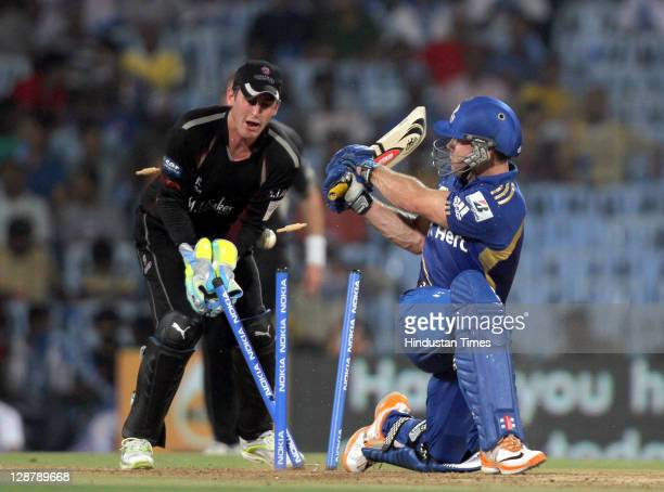 Mumbai Indian batsman Aiden Blizzard being bowled by Somerset bowler Murali Kartik as wicket keeper Craig Kieswetter looks on during the Champions...