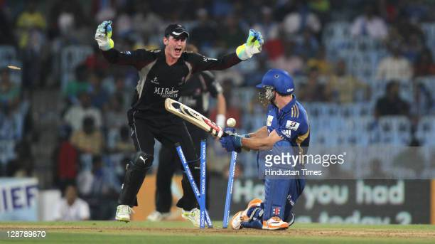 Mumbai Indian batsman Aiden Blizzard being bowled by Somerset bowler Murali Kartik as wicket keeper Craig Kieswetter celebrates during the Champions...