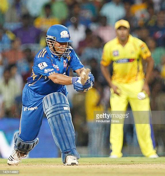 Mumbai Indian batsman SachinTendulkar plays a shot during inaugural cricket match of Indian Premier League 2012 played between Mumbai Indians And...
