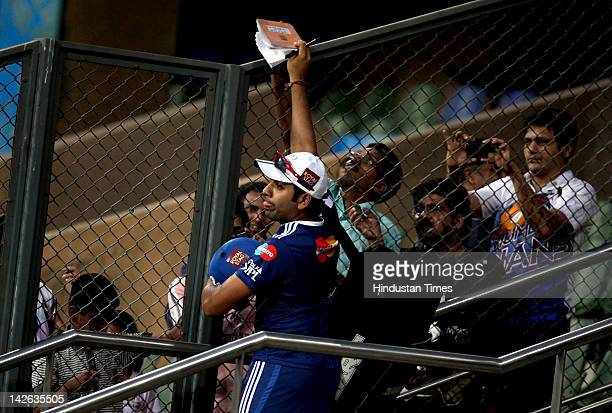 Mumbai Indian player Rohit Sharma signs autographs during a nets practice session at Wankhade Stadium on April 10 2012 in Mumbai India The Mumbai...
