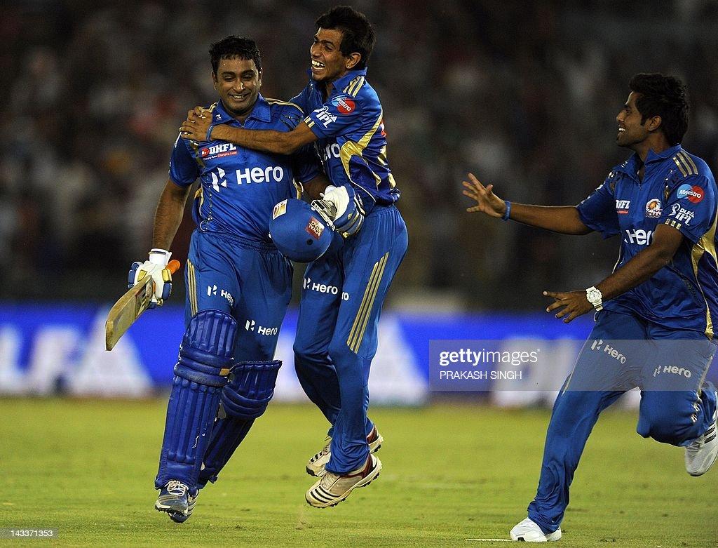 Mumbai Indians batsman Ambati Rayudu (L) celebrates his team's victory with teammates during the IPL Twenty20 cricket match between Kings XI Punjab and Mumbai Indians at PCA Stadium in Mohali on April 25, 2012. RESTRICTED TO EDITORIAL USE. MOBILE USE WITHIN NEWS PACKAGE AFP PHOTO/ Prakash SINGH
