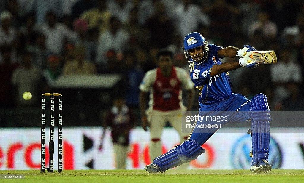Mumbai Indians batsman Ambati Rayudu plays a shot during the IPL Twenty20 cricket match between Kings XI Punjab and Mumbai Indians at PCA Stadium in Mohali on April 25, 2012. RESTRICTED TO EDITORIAL USE. MOBILE USE WITHIN NEWS PACKAGE AFP PHOTO/ Prakash SINGH