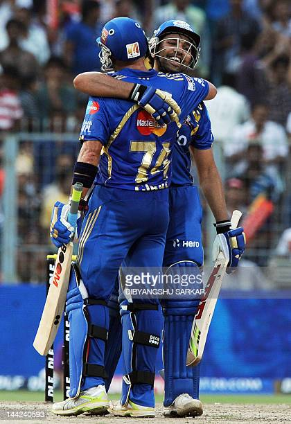Mumbai Indians batsman Herschelle Gibbs congratulates teammate Rohit Sharma for his century during the IPL Twenty20 cricket match between Kolkata...