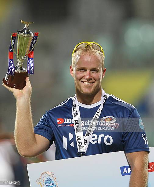 Mumbai Indians Batsman Richard Levi holds up his trophy after being announced Man of Match for his perfomance during the IPL Twenty20 cricket match...