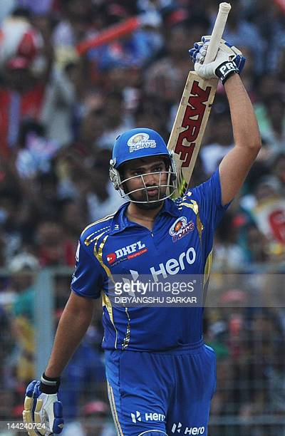 Mumbai Indians batsman Rohit Sharma celebrates after scoring a century during the IPL Twenty20 cricket match between Kolkata Knight Riders and Mumbai...