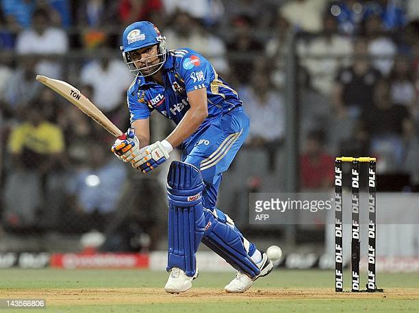 Mumbai Indians batsman Rohit Sharma plays a shot during the IPL Twenty20 cricket match between Mumbai Indians and Deccan Chargers at the Wankhede...